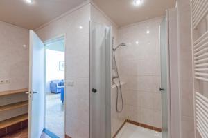 A bathroom at Fletcher Hotel Restaurant Bon Repos