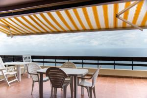 A balcony or terrace at Apartment with a stunning view over Sesimbra