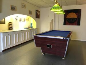 A pool table at The Norton Hotel