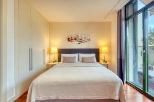 Letto o letti in una camera di Paseo de Gracia Bas Apartments Barcelona