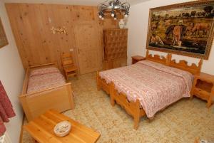Postel nebo postele na pokoji v ubytování Baita Guana