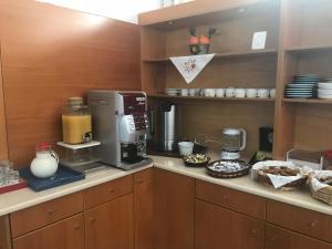 A kitchen or kitchenette at Aretousa Hotel
