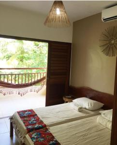 A bed or beds in a room at Estalagem Thereza da Praia
