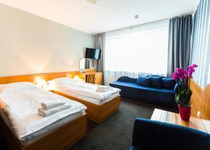 Łóżko lub łóżka w pokoju w obiekcie Baltic Inn