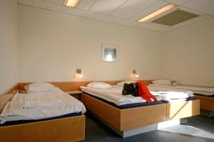A bed or beds in a room at BB-Hotel Rønne Bornholm