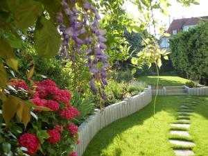 A garden outside Hotel Beausejour Colmar