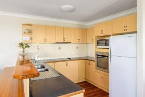 A kitchen or kitchenette at 2/80 Cooloola Drive - Comfortable and cosy unit enjoying ocean views and views to Fraser Island