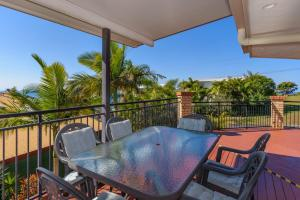 A balcony or terrace at 2/80 Cooloola Drive - Comfortable and cosy unit enjoying ocean views and views to Fraser Island