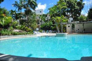 The swimming pool at or near 32/15 Rainbow Shores - Unit overlooking bushland with shared swimming pool, spa and tennis court