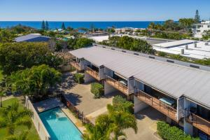 A view of the pool at Unit 1 Rainbow Surf - Modern, two storey townhouse with large shared pool, close to beach and shop or nearby