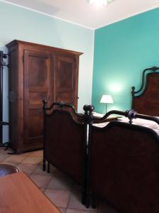 A bed or beds in a room at B&B A CASA DI ROSA