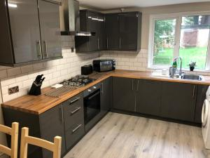 A kitchen or kitchenette at 5 Bed Camberley Airport Accommodation