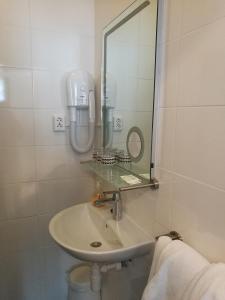 Salle de bains dans l'établissement New City Hotel Scheveningen
