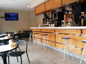 The lounge or bar area at Hotel Carbayon