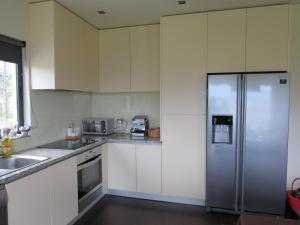 A kitchen or kitchenette at Casa Nova