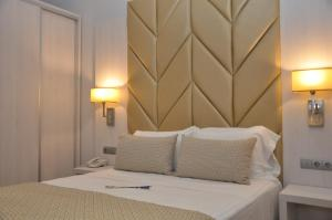 Кровать или кровати в номере Hotel Selu