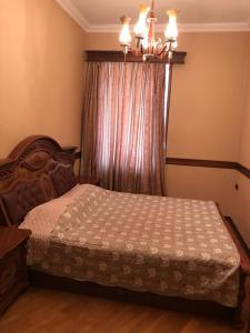Cama ou camas em um quarto em Boulevard Apartment