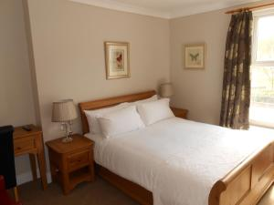 A bed or beds in a room at South Park Guest House