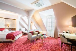 Кровать или кровати в номере Best Western Plus Hotel StadtPalais