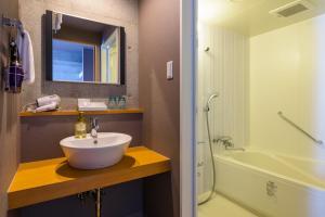 A bathroom at NAHA-WEST INN