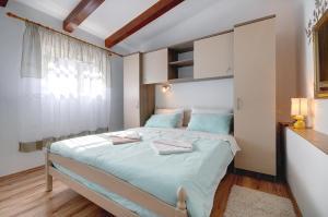 Krevet ili kreveti u jedinici u objektu Apartments Faris