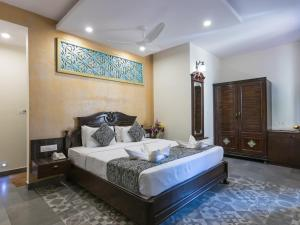 A bed or beds in a room at Resort Terra Paraiso