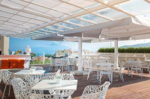 Restaurant ou autre lieu de restauration dans l'établissement Hotel Plaza
