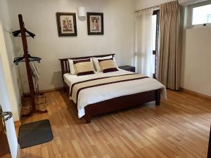 A bed or beds in a room at 1 Br Apartment 2-4 in 7HCR Residencies