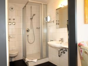 A bathroom at SEEGER Living Comfort Downtown