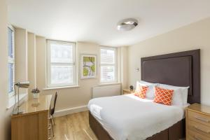 A bed or beds in a room at Central House