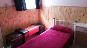 A bed or beds in a room at Hospedaje La Serranita