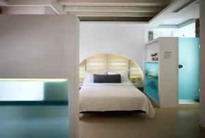 A bed or beds in a room at Semeli Hotel