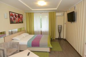 """Кровать или кровати в номере Hotel """"Otel flowerS"""""""