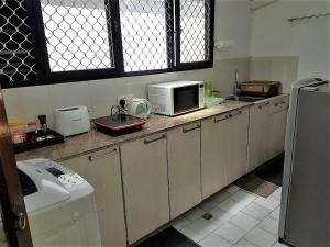 A kitchen or kitchenette at 7HCR 1-6 Self-Catering Apt at 7, Hunupitiya Cross Rd