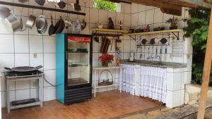 A kitchen or kitchenette at Pousada Estância das Angolas