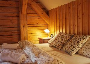 Postel nebo postele na pokoji v ubytování Bruckneruv Dum