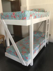 A bunk bed or bunk beds in a room at Hostel Morro de Sao Paulo