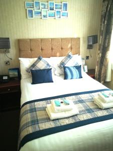 A bed or beds in a room at Torbay Court Hotel