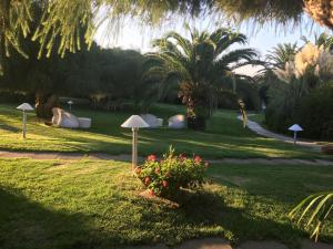 A garden outside Cala Rosa Club Hotel