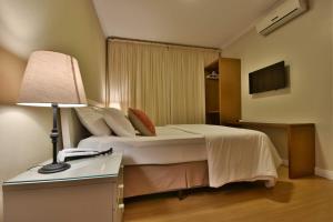 A bed or beds in a room at Pousada Ares da Serra