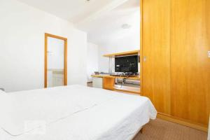 A bed or beds in a room at Flat Piemonte