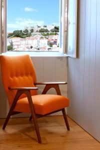A seating area at Lisboa Carmo Hotel