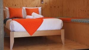 A bed or beds in a room at BAY OF FIRES ECO HUT off grid experience at Binalong Bay