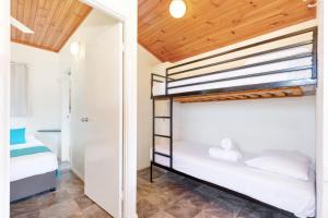 A bunk bed or bunk beds in a room at Fisherman's Beach Holiday Park