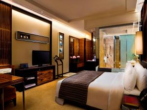 A television and/or entertainment center at The Fullerton Bay Hotel Singapore (SG Clean, Staycation Approved)