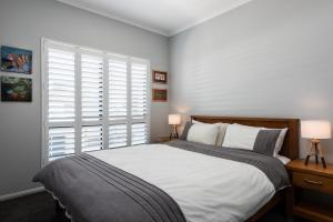 A bed or beds in a room at Ocean Break Coolum
