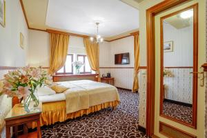 A bed or beds in a room at Chateau St. Havel - Wellness Hotel