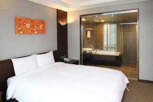 A bed or beds in a room at Mstay Hotel