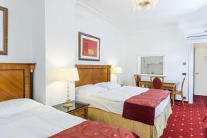 Postel nebo postele na pokoji v ubytování Residence Bologna