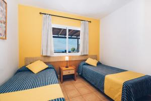 A bed or beds in a room at Tacande Bocayna Village, Feel & Relax, Lanzarote
